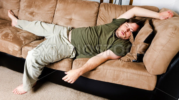 A guy flung all over the couch – Stock Images 4 You