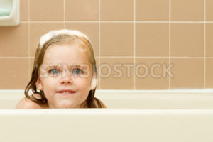 A little peek and a tiny smile - Stock Images 4 You