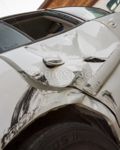 Auto crash with a caved in door - Stock Images 4 You