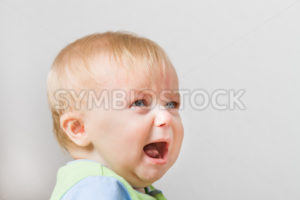 Boy looking up into space screaming - Stock Images 4 You
