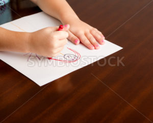 Child drawing a little person - Stock Images 4 You