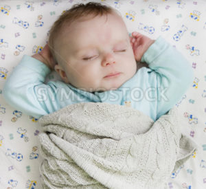 Child resting on a bed - Stock Images 4 You