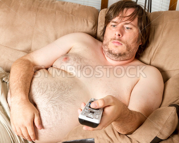 Fat lazy guy watching the TV – Stock Images 4 You