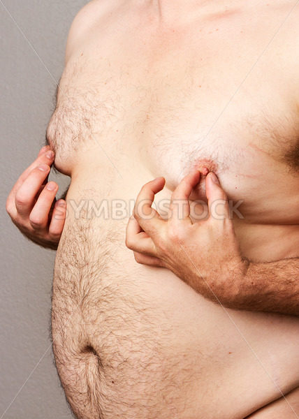 Fat man at his nipples – Stock Images 4 You