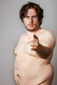 Fat naked man pointing firmly - Stock Images 4 You