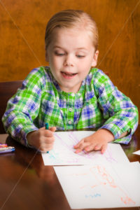 Happy young girl drawing a picture for mommy. - Stock Images 4 You
