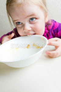 Hungry girl not given enough food. - Stock Images 4 You