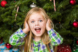 Kid is quite happy about her christmas - Stock Images 4 You
