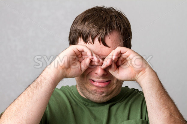 Man trying to take away the tears – Stock Images 4 You