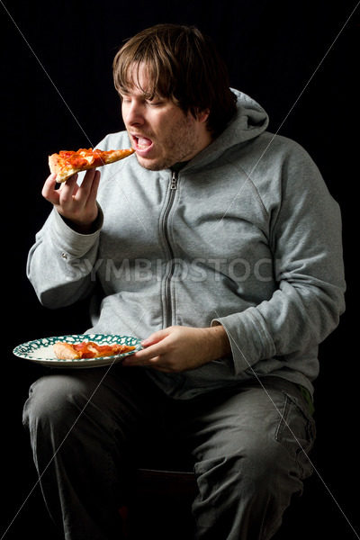 Overweight man eating a pizza. – Stock Images 4 You
