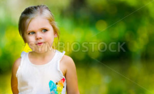 Portrait of a little girl looking into space - Stock Images 4 You