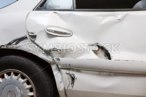 Profile view of a dented car with a hole - Stock Images 4 You