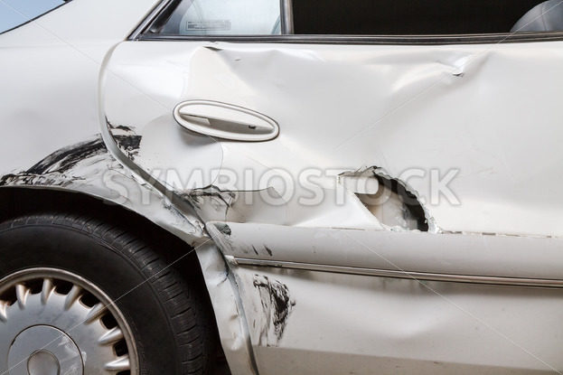 Profile view of a dented car with a hole – Stock Images 4 You
