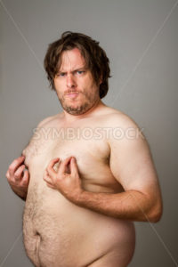 Sensual fat man playing with his nipples - Stock Images 4 You