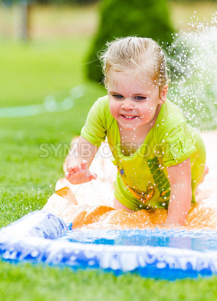 Smiling girl cooling off on a hot summer day – Stock Images 4 You