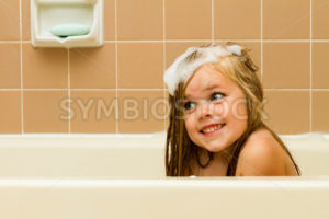 The suds of soap and a smile - Stock Images 4 You
