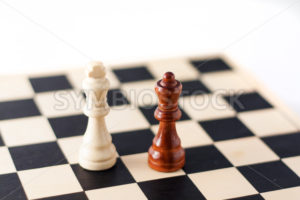 Two chess pieces on the chess board. - Stock Images 4 You