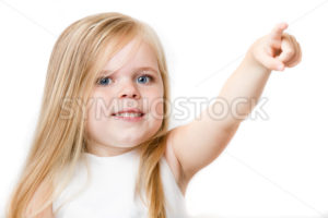 Young girl pointing to the upper right - Stock Images 4 You