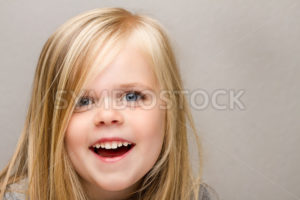 Young girl with a huge smile on her face. - Stock Images 4 You