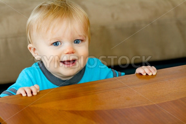 Young little boy holding himself up – Stock Images 4 You