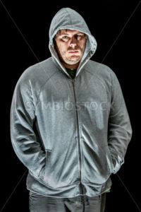 Young man with hands in sweater  - Stock Images 4 You