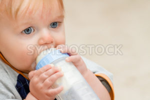 Young toddler boy drinking bottle - Stock Images 4 You