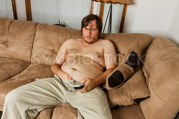 fat guy laying on the couch  – Stock Images 4 You