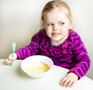 girl eating who ate all her food - Stock Images 4 You