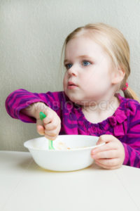 hungry little girl - Stock Images 4 You