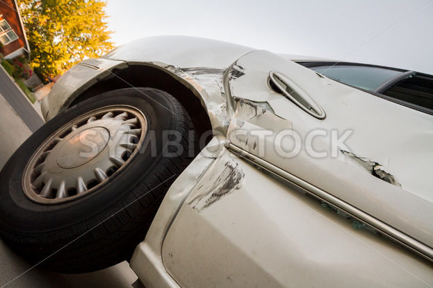 Angled up view looking up at the damage from a car wreck – Stock Images 4 You
