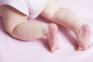 Baby girl crawling away on a blanket - Stock Images 4 You