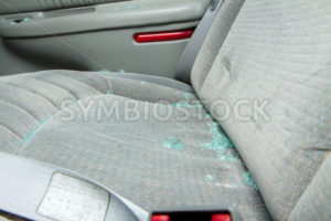 Broken glass sittin on a seat of a car - Stock Images 4 You