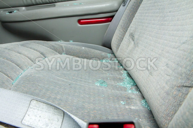 Broken glass sittin on a seat of a car – Stock Images 4 You