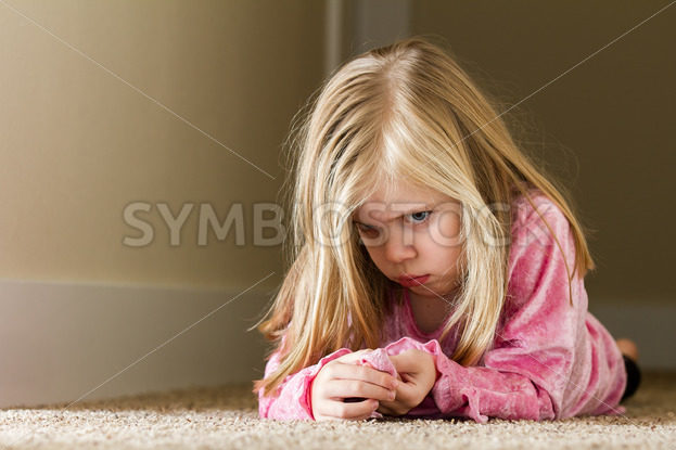Child laying in the hallway sad – Stock Images 4 You