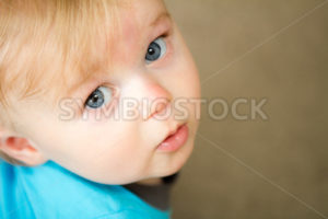 Child looking up at the viewer - Stock Images 4 You