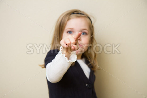 Child pointing at the camera – Stock Images 4 You