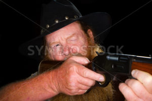 Close up of an older cowboy about to pull the trigger - Stock Images 4 You