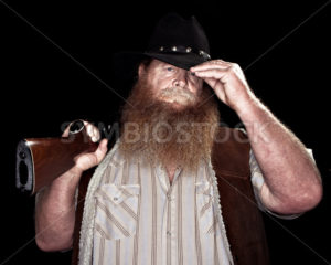 Cowboy holding his rifle while tipping his hat - Stock Images 4 You