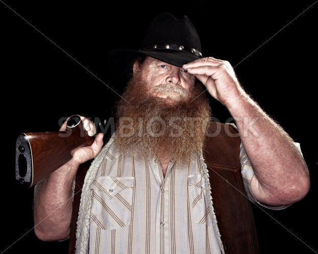 Cowboy holding his rifle while tipping his hat – Stock Images 4 You
