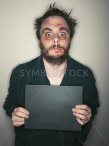 Crazy looking mans mug shot - Stock Images 4 You