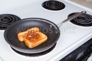 Grilling up a cheese sandwich - Stock Images 4 You