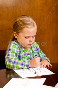Hard at work on trying to impress mommy - Stock Images 4 You