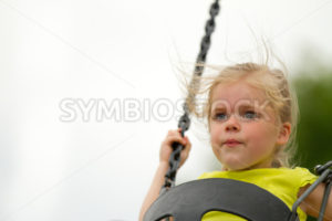 Having fun on the swings - Stock Images 4 You