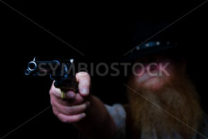 Hiding in the darkness before he shoots - Stock Images 4 You