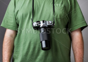 Man against gray background with camera strapped to him - Stock Images 4 You