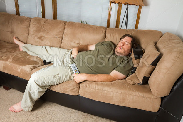 Man asleep on the couch – Stock Images 4 You