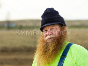 Man getting ready to tend to his farm in the morning - Stock Images 4 You