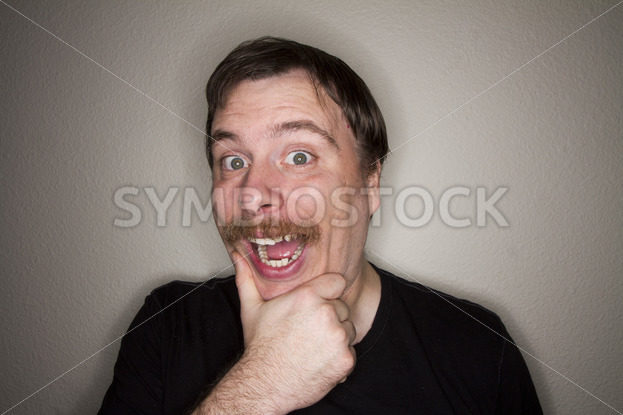 Man holding his chin making a very big smile – Stock Images 4 You