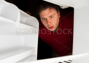 Man looks to his fridge for a snack - Stock Images 4 You
