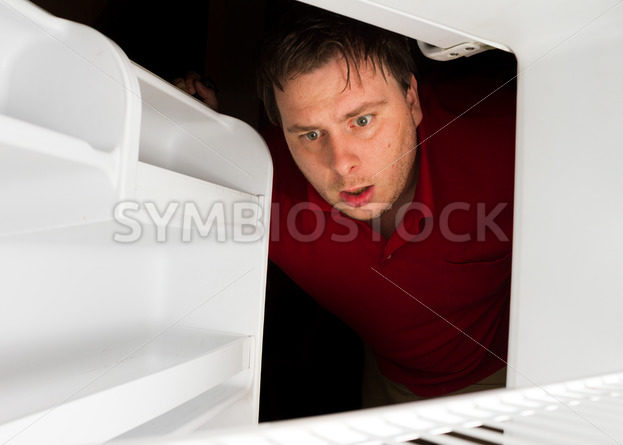 Man looks to his fridge for a snack – Stock Images 4 You